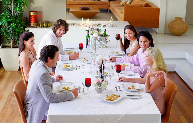 group of adults dining