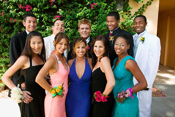 Group of teens posing for prom picture