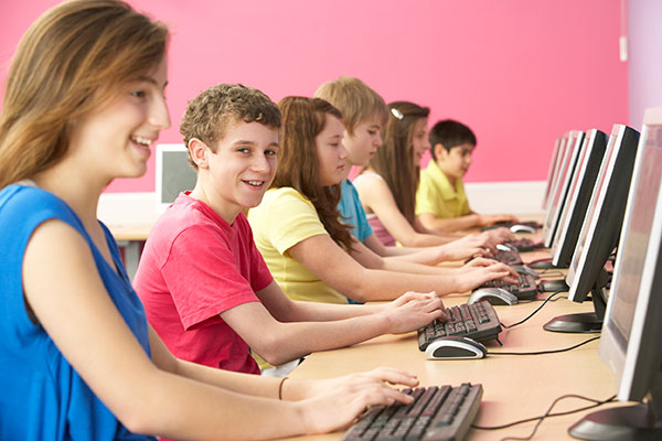 Children and pre-teens in computer lab