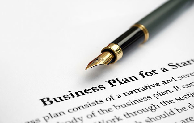 Business plan with ink pen